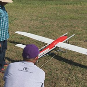 two men with a drone