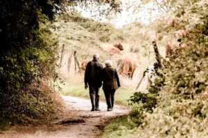 two adults walking