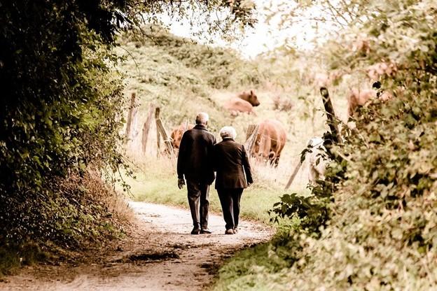 two adults walking