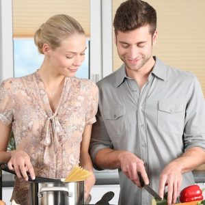 man and women cooking in the kitchen
