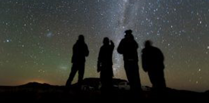 four people looking at stars