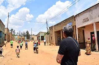 Bryan Willson admiring the hybrid microgrid in the village of Gitaraga